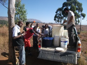 Fetching water in order to plaster Tholakele's house