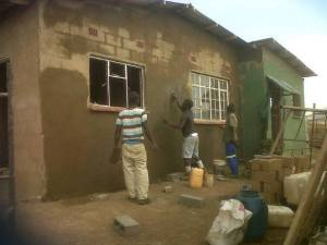 Guys plastering the house
