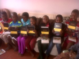 Kids recieving Bibles
