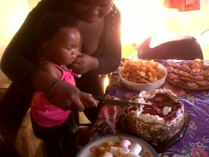 Neighbour's party for baby girl. At the Sithole homestead.