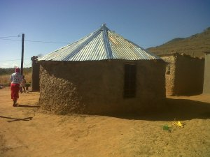 Tholakele's roofing sorted on her mud hut.