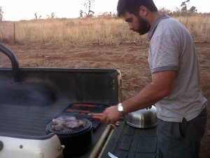 Salvador cooking meat on a Cobb Braai (BBQ)