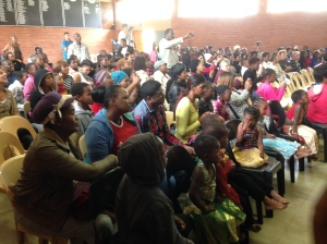 Parents watch their children at the Joyland creche end of year concert.
