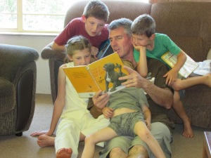 Riaan reading to his kids