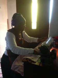 Celani using her sewing machine
