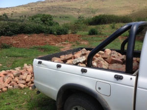 Helping Mkhulu fetching his bricks so he can build in the future