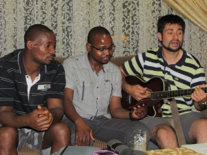 Kingsley, Clayton and Salvador sing at Kingsley's house.