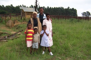 Khethiwe in 2004 when she attended kids club. She is standing on the right of her mother Celani.