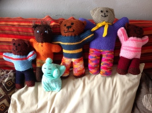 Family of knitted toys needing a home