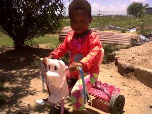 Ncedo on her bike
