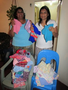 Giving out jumpers to bible study members in Stanger