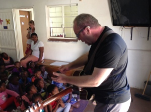 John teaches the children a new song
