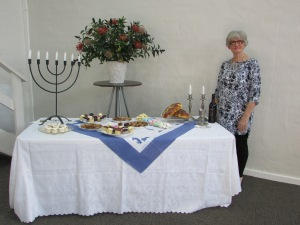 Judy set up the table for Shavvu'ot at Coming King Ministries (CKM).