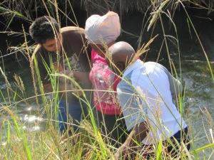Baptising Nomusa.