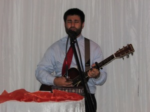 Salvador leading Worship at the Bridal Meeting