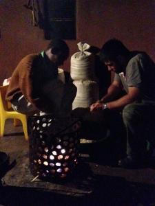 Helping Phumlani pluck mealies