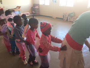 Di leads kids at Sicelo creche with costumes